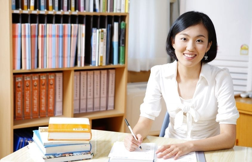 asian teacher preparing her lesson
