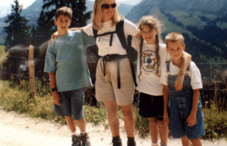 woman on a hike with her three children
