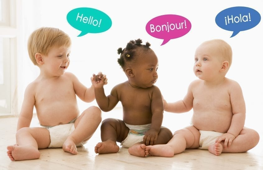 """three multiracial babies with various language bubbles saying """"hello"""""""